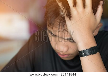 Education Test Concept : Asian Boy Student Studying Stressed Headaches For Exams In Classroom, Learn