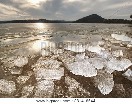 Broken Floes And  Iceberg. A Large Ice Piece On Freshwater Ice That Has Broken Off A Glacier Or An I