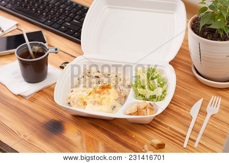 Container For Food On A Wooden Table In The Office