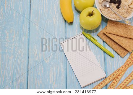 Healthy Eating, Fitness And Weight Loss Concept, Apple, Notepad, Pencil. The View From The Top
