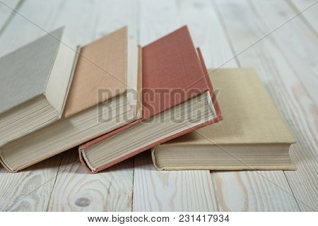 Chaotic Stack Of Old Books Pastel Colors, Selective Focus With Copy Space