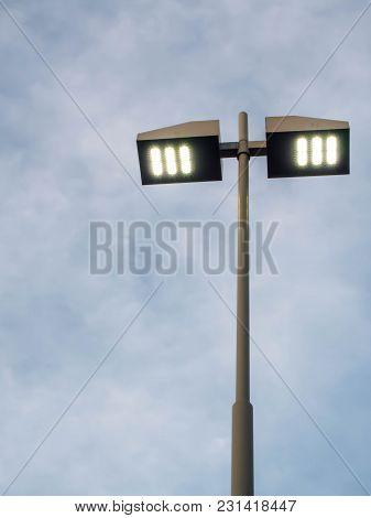 Tall Pillar Spotlights On Blue Sky Background