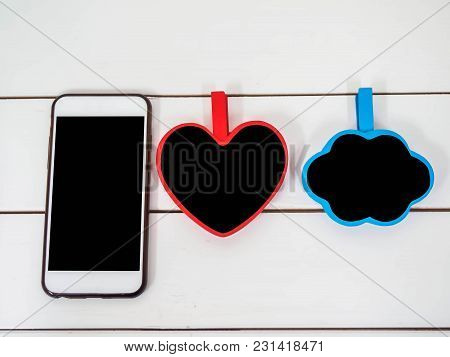 Mobile Phone On White Chair Background With Small Board Cloudt And Heart, Black Space For Insert Tex