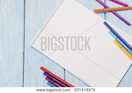 Colored Felt Pens And Sheet Of White Paper.