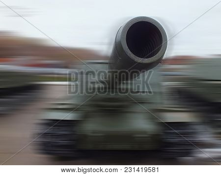 The Gun Barrel Is Very Close. The Vague Figure Of A Tank