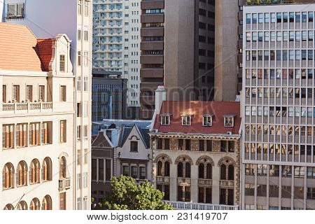 Historical And Modern Buildings On A Street In The Commercial District Of A City On A Sunny Day