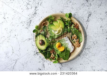 Vegetarian Sandwiches With Avocado, Ricotta, Egg Yolk, Spinach, Walnuts On Whole Grain Toast Bread O