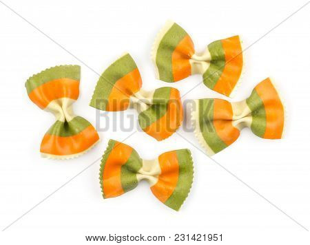 Farfalle Pasta With Green Spinach And Orange Carrot Isolated On White Background Top View Five Raw C