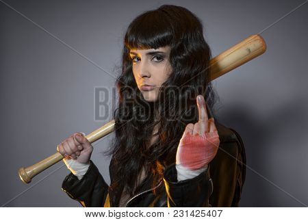 lawbreaker, adolescence and delinquency, brunette woman in leather jacket and baseball bat with challenging aptitude
