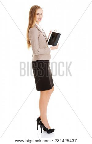 Beautiful caucasian business woman with tablet. Isolated on white.