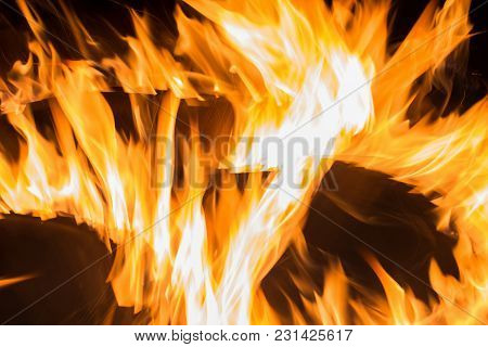 Abstract Stylized Bright Fire Background In The Night