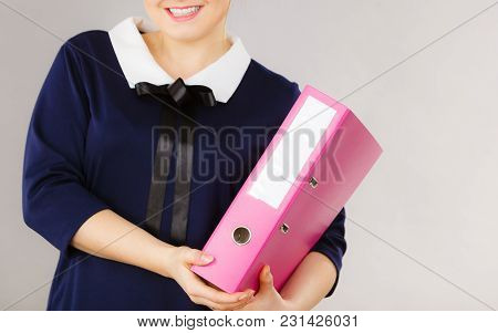 Happy Positive Accountant Business Woman Holding Binder With Documents, Enjoying Her Work.