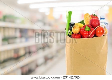 Grocery Shopping Concept Image - Eco Friendly Paper Shopping Bag Filled With Various Food Products O