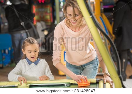 Selective Focus Of Beautiful Happy Mother And Daughter Playing Air Hockey