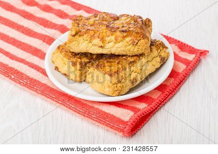 Shortbread Cookies With Peanuts In Saucer On Red Napkin On Wooden Table