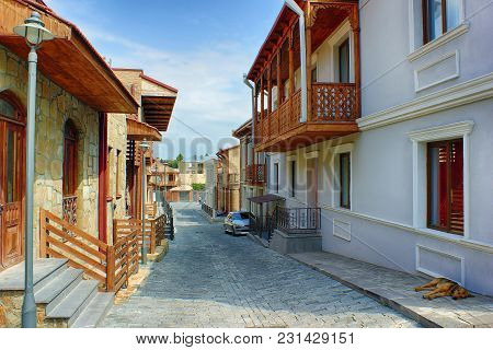 Cityscape. The Old Georgian City. A Cobbled Narrow Street Sloping Down Between Low Houses. A Sleepin