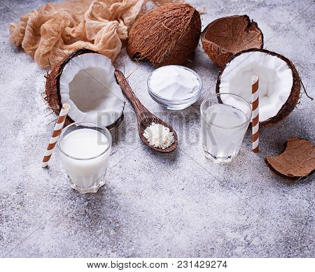 Set Of Coconut Products. Milk, Water, Oil And Shavings. Selective Focus