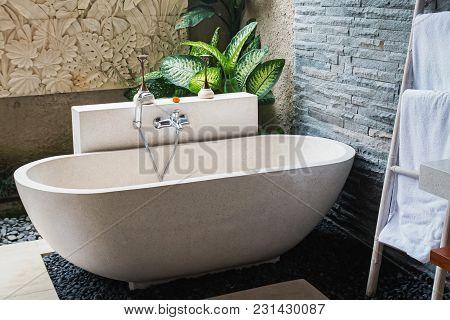 Interior Of The Beautiful Bathroom With Stone Bathtub In A Luxury Villa