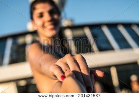 Girl holding boyfriend hand - Follow me shot