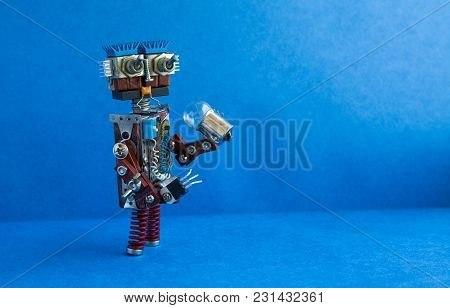 Futuristic Robot Concept. Friendly Cyborg Character Funny Head, Big Eyes, Light Bulb In Hand. Copy S