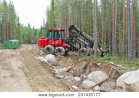 Harvesting Machine Near The Forest Path Waiting Before Next Work. Wood Industry In Russia