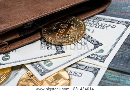 Bitcoin And Money In A Purse On A Colored Wooden Background. Bitcoin Golden Coin New Virtual Money