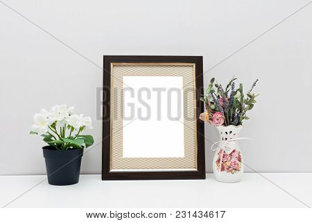 Mockup 8x10 - A Dark Wooden Frame With With Passepartoutt And Flowers. Portrait Orientation.