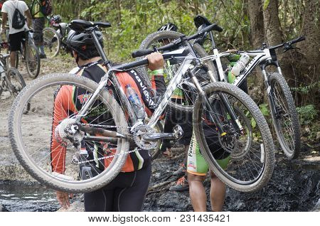 San Pedro Macoris, Dominican Republic - Mar 19, 2017: Unidentified Mountainbikers Crossing Mayen Lag