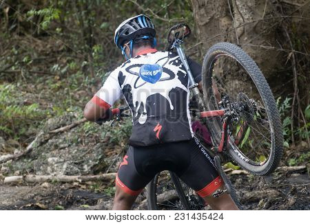 San Pedro Macoris, Dominican Republic - Mar 19, 2017: Unidentified Mountainbiker Crossing Mayen Lago