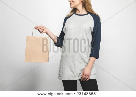 Woman In Stylish Long Sleeve On White With Shopping Bag