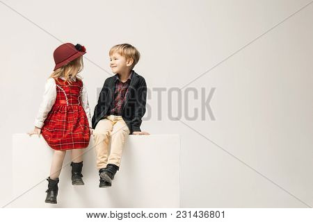 Cute Stylish Children On White Studio Background