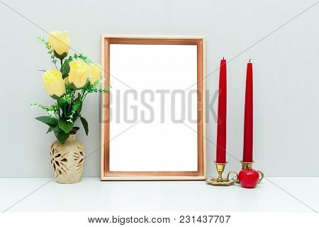 A4 Wooden Frame Mockup With Yellow Flowers And Red Candles Of A Romantic Style. Portrait Orientation