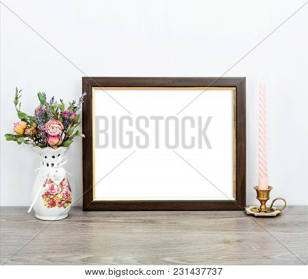 Minimalistic Mockup 8x10 With Pink Candles And Flowers On Gray Rustic Table. Portrait Orientation.