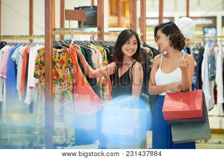 Beautiful Female Friends Shopping Together In The Mall