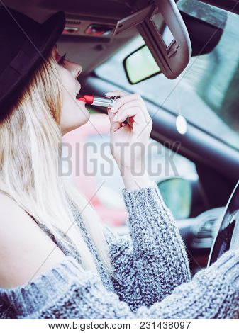 Young Attractive Woman Looking In Rear View Mirror Painting Her Lips Doing Applying Make Up While Dr
