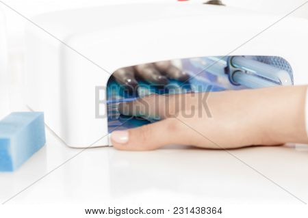 Woman Hand In Uv Led Lamp Drying Gel Manicure