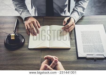 Businessman And Male Lawyer Or Judge Consult Having Team Meeting With Client, Law And Legal Services