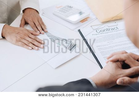 Bribery And Corruption Concept, Bribe In The Form Of Dollar Bills, Businessman Giving Money In The E