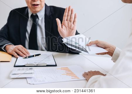 Bribery And Corruption Concept, Senior Businessman Manager Refusing Receive Money In The Envelope To