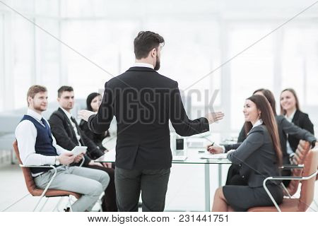 Ceo Speaks At The Workshop Business Team In A Modern Office. The Photo Has A Empty Space For Your Te