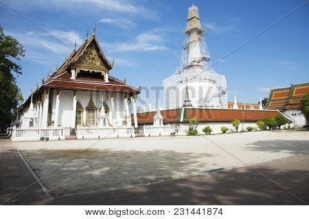 Thai people visit travel and  respect praying chedi and ubosot of Wat Phra Mahathat Woramahawihan on October 5, 2017 in Nakhon Si Thammarat, Thailand poster