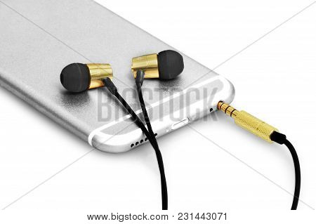 Premium Black And Golden Earphone Attached In A Silver Elegant Phone. Perfect For Listening And Cont