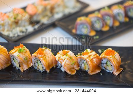 Salmon Sushi Nigiri Grilled Served On Black Plate