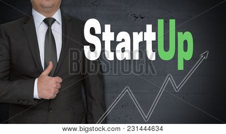 Startup Concept And Businessman With Thumbs Up.
