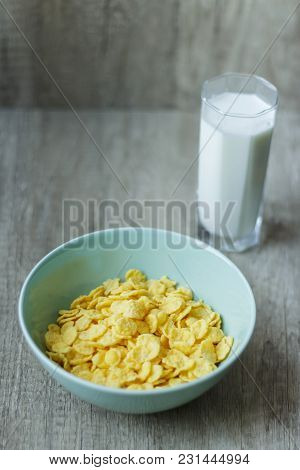 Flakes In A Plate And A Glass Of Milk
