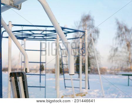 Sport Equipment In A Park, Daytime Frosty Scene