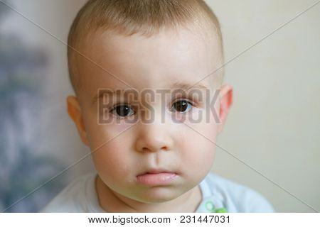 Sad Little Baby Boy Looking At Camera. Caucasian Child 2 Years Old. Closeup Portriat