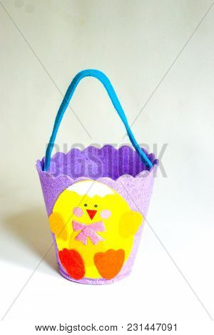 Easter Basket Made Of Felt Fabric Of Different Colors Aqua,lavender,white,yellow Orange And Red.