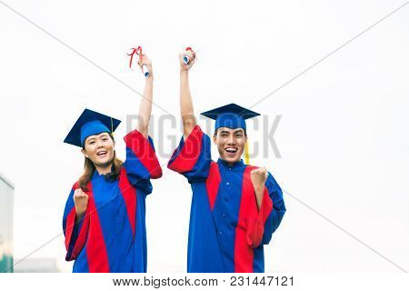 Excited Happy Young Vietnamese People With Diplomas