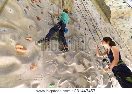 Young Sporty Couple Of Climbers In A Climbing Hall